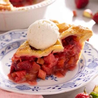 A slice of strawberry rhubarb pie with ice cream on top.