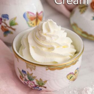 Pinterest graphic of a small bowl of whipped cream by a pink linen napkin.