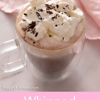 Pinterest graphic of a cup of hot chocolate with whipped cream and chocolate shavings.