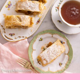 Pinterest graphic of the overhead view of cut apple strudel with a plate with one slice on it.
