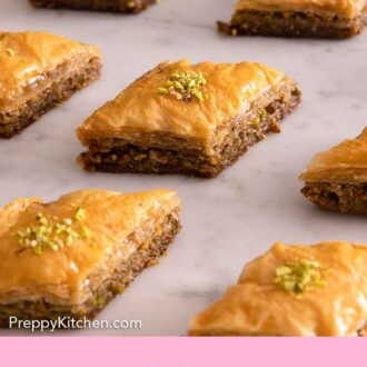Pinterest graphic of baklava pieces on a marble surface.