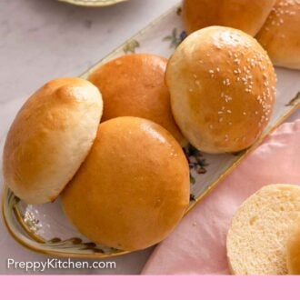 Pinterest graphic of a platter of brioche buns with a couple that are cut around it.