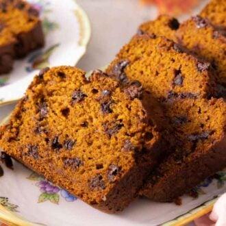 A platter of sliced chocolate chip pumpkin bread.