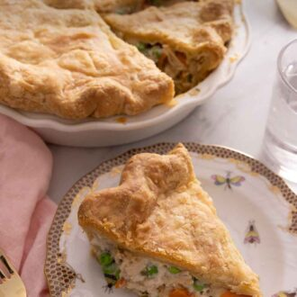 Pinterest graphic of a plate with a slice of chicken pot pie in front of the rest of the dish.