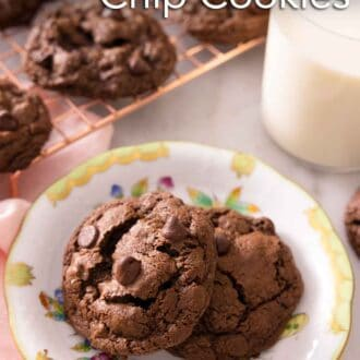 Pinterest graphic a plate of two double chocolate chip cookies with a cooling rack in the background with more cookies.