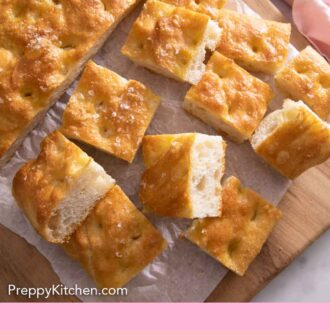 Pinterest graphic of a piece of focaccia cut into bite-sized cubes.