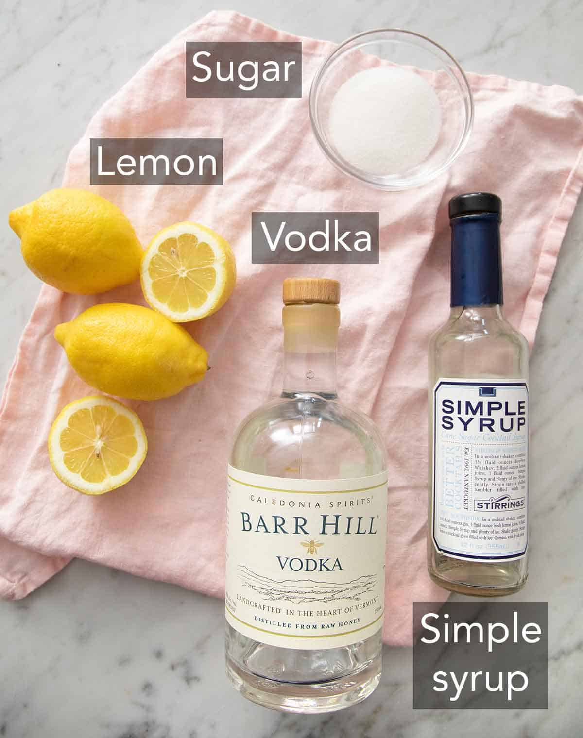 Ingredients needed to make a lemon drop martini.