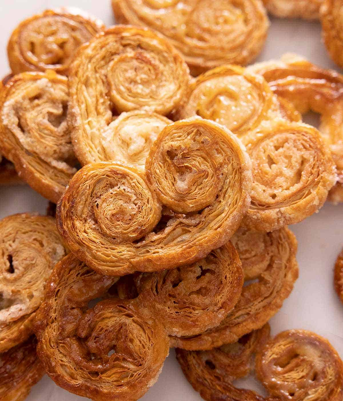 A pile of palmiers, stacked on top of each other with one pamier at the top.