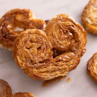 A palmier propped on top of another.