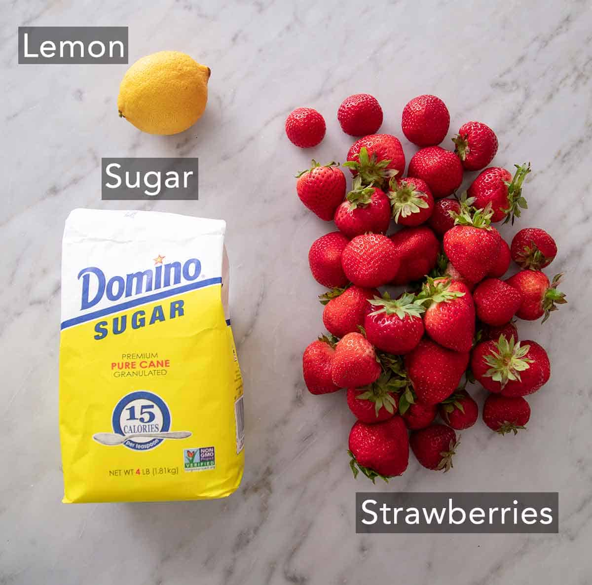 Ingredients needed to make strawberry jam.