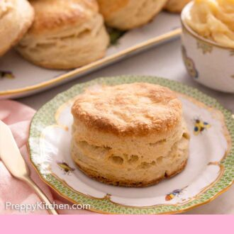 Pinterest graphic of a biscuit on a plate with more biscuits in the background on a platter.