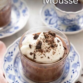 Pinterest graphic of a glass of chocolate mousse with whipped cream on top and shaved chocolate.