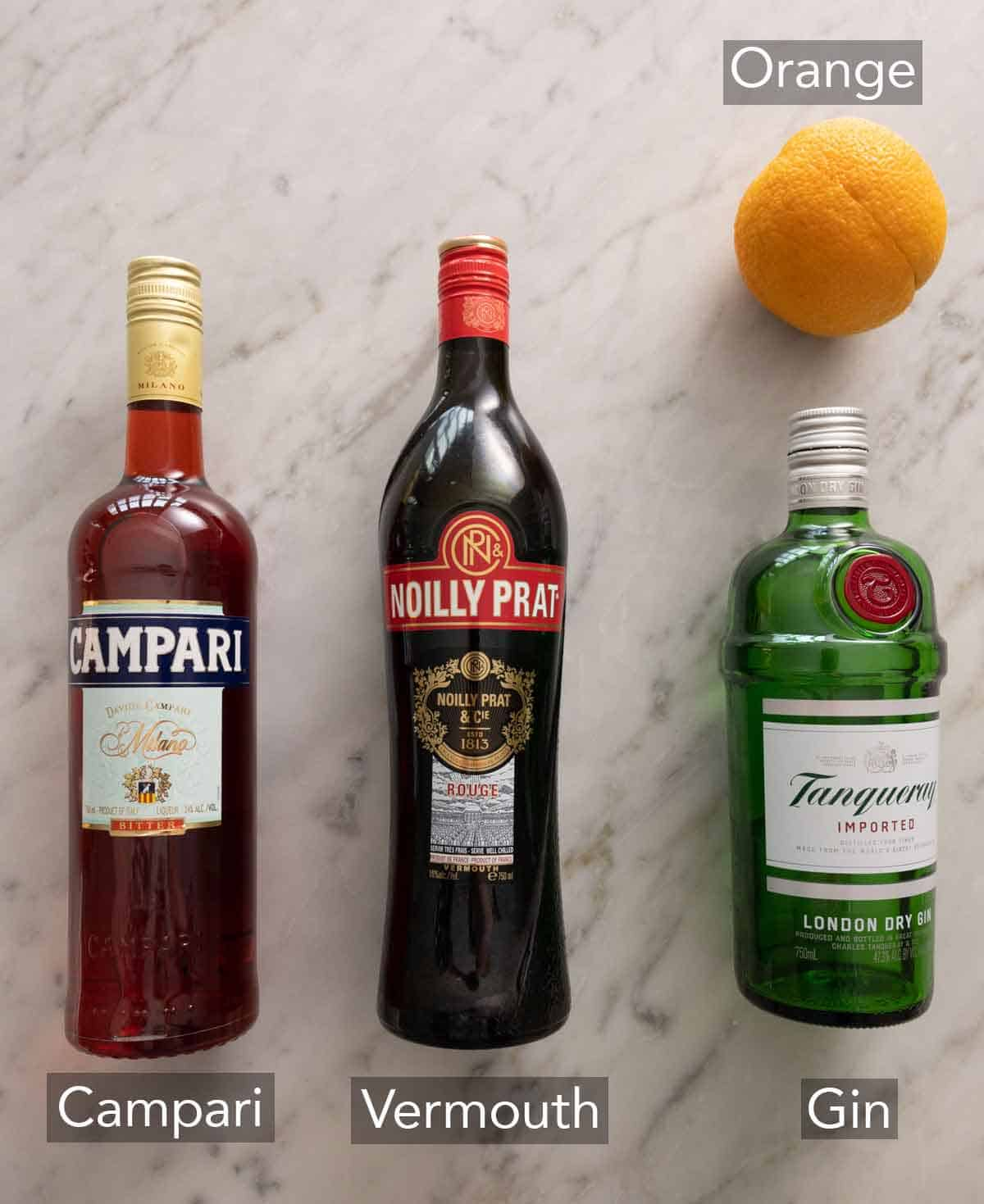 Ingredients needed to make a Negroni.