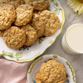 Pinterest graphic of a plate with two peanut butter oatmeal cookies beside a platter of more cookies.