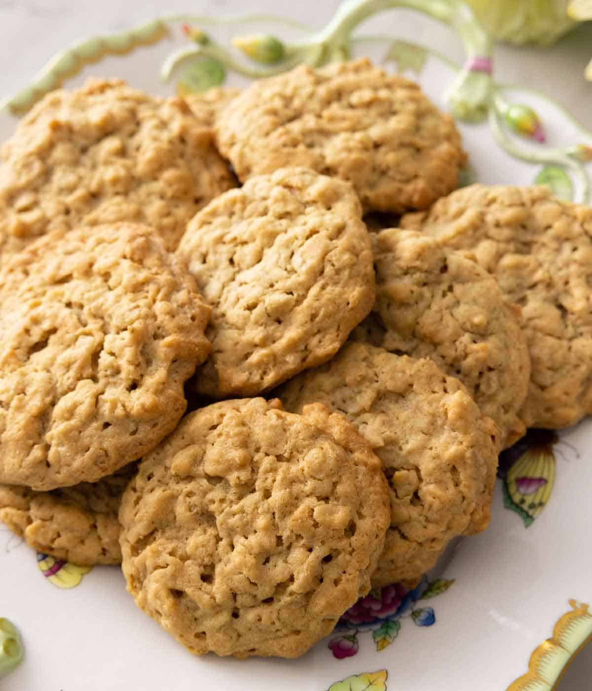 A plate with a bunch of peanut butter oatmeal cookies.
