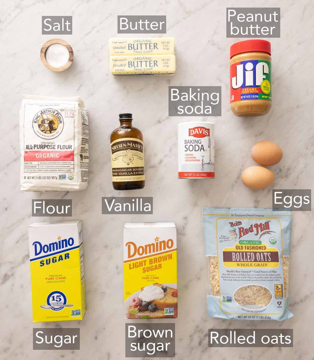 Ingredients needed to make peanut butter oatmeal cookies.