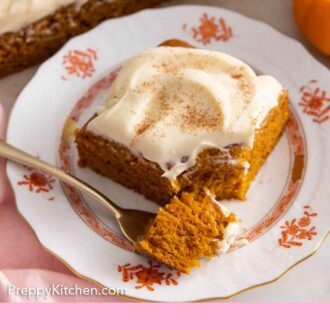 Pinterest graphic of a plate with a square slice of pumpkin cake with a fork in front, with a piece on it.