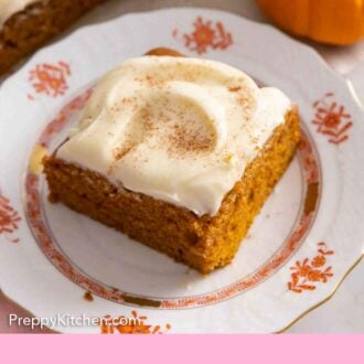 Pinterest graphic of a plate with a square slice of pumpkin cake with cream cheese frosting on top.