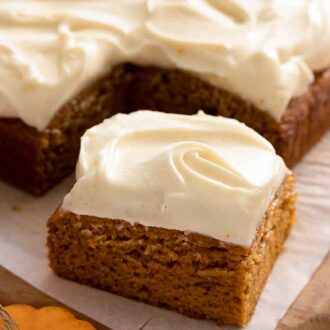 A pumpkin cake with one square cut out and pulled forward.