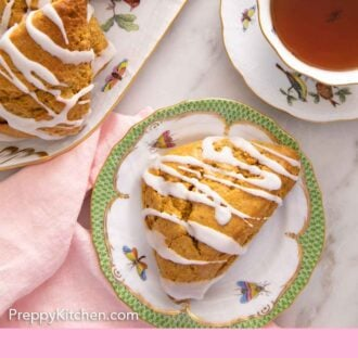 Pinterest graphic of the overhead view of a plate with a pumpkin scones beside a cup of tea by a platter of more scones.