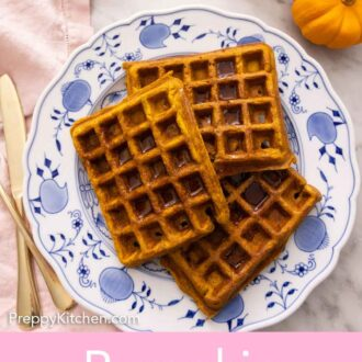 Pinterest graphic of three pumpkin waffles on a plate with syrup on top.