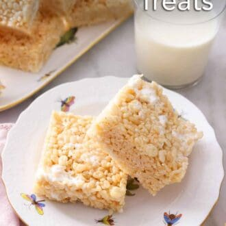 Pinterest graphic of a plate of two rice crispy treats with one propped on the other in front of a glass of milk.