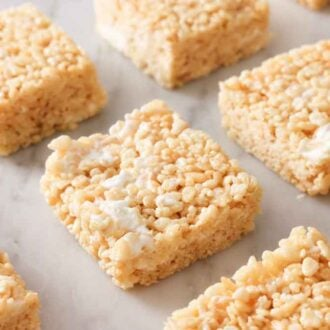 Multiple rice crispy treats laid out in a grid.
