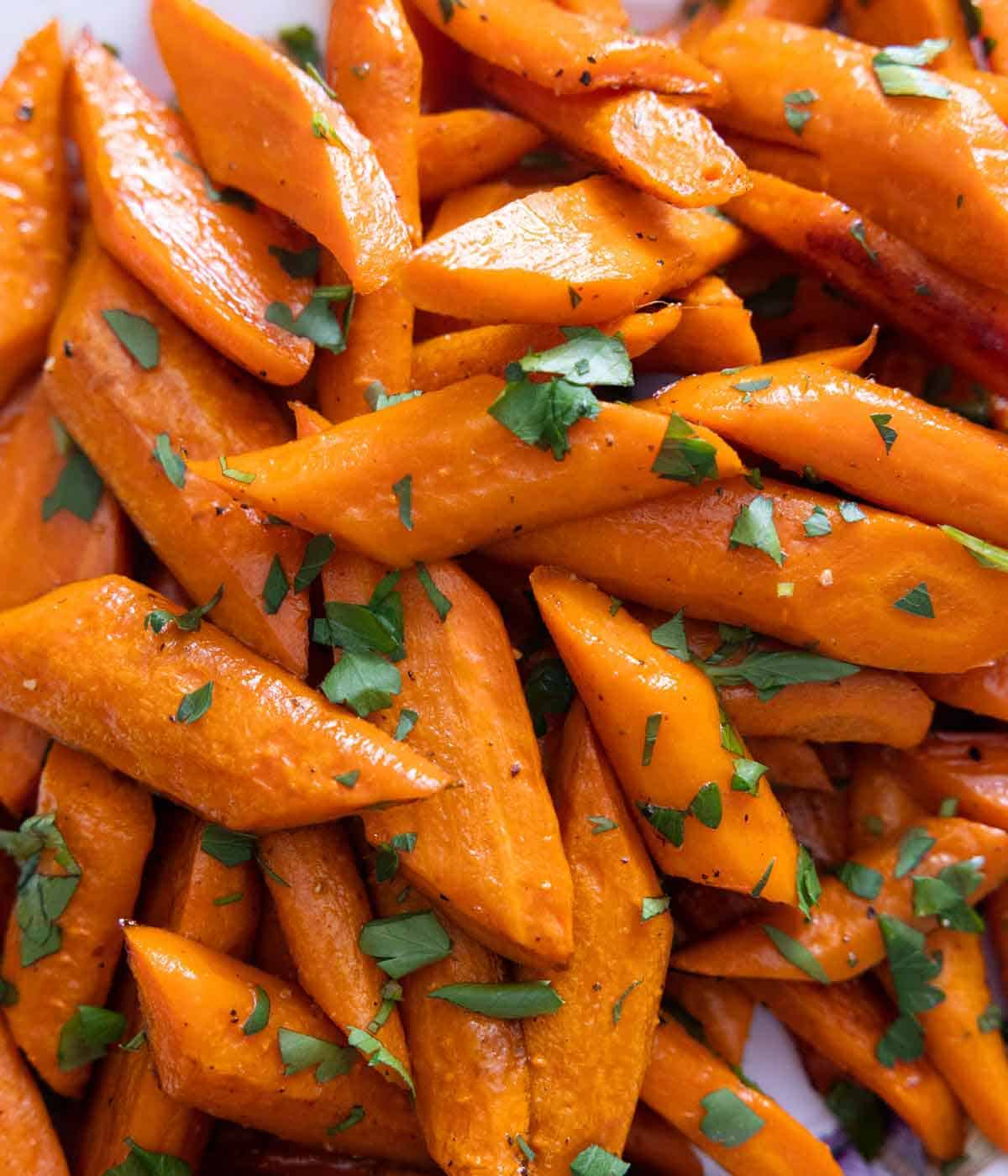 Close up of diagonally cut carrots, roasted.