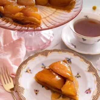Pinterest graphic of a slice of tarte Tatin on a plate in front of a pink serving platter with the rest of the Tatin.