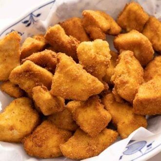 An oval plate of chicken nuggets.