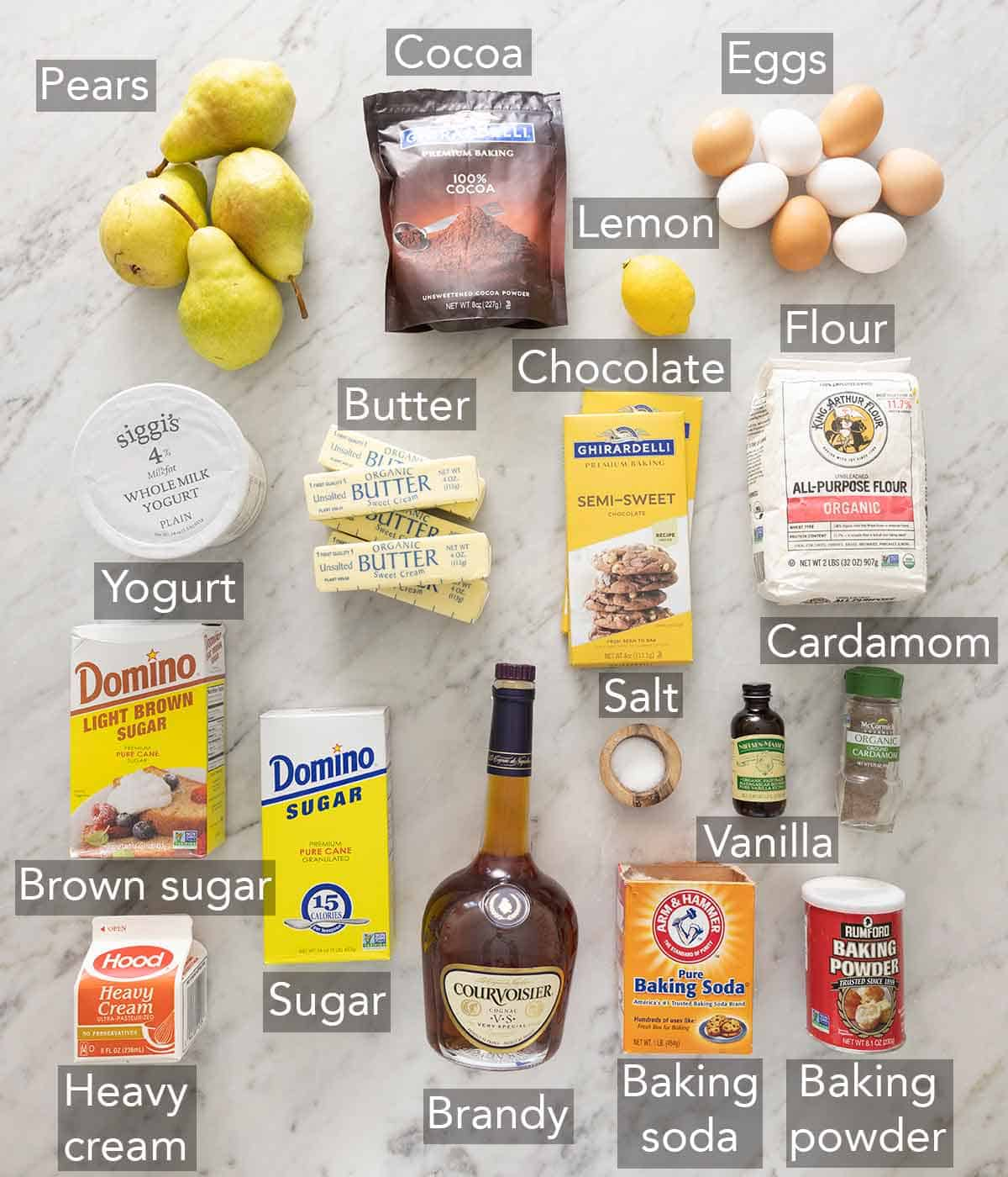 Ingredients needed to make a chocolate pear cake.