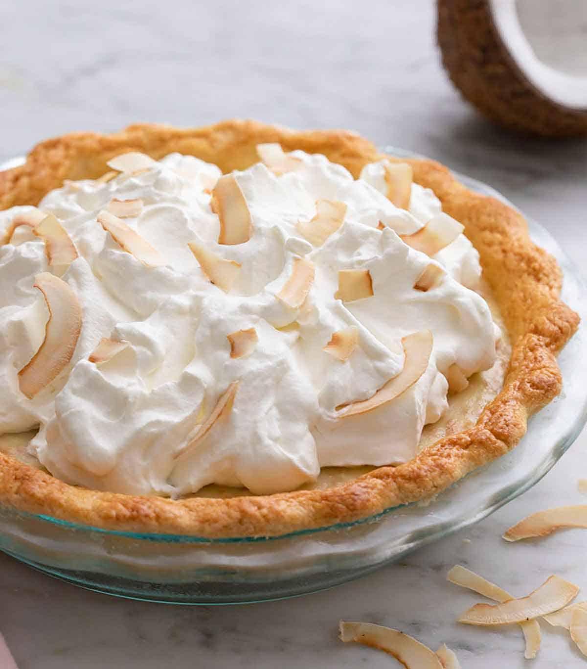 A coconut cream pie in a pie dish.