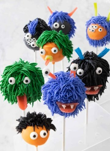 Eight Halloween cake pops decorated like monsters.