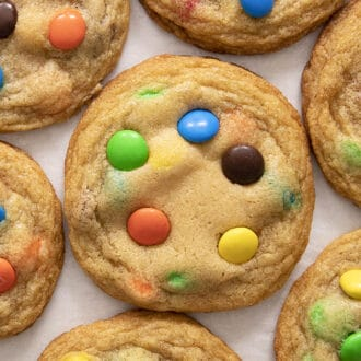 Colorful M&M Cookies on a white counter.