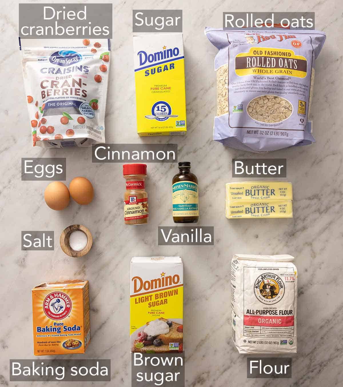 Ingredients needed to make oatmeal cranberry cookies.