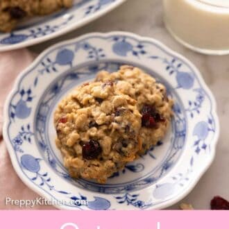 Pinterest graphic of a plate with two oatmeal cranberry cookies.