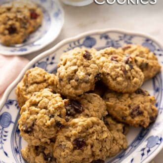 Pinterest graphic of a platter of oatmeal cranberry cookies.