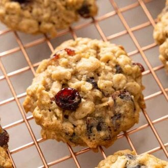 Overhead view of oatmeal cranberry cookies on a cooling rack.