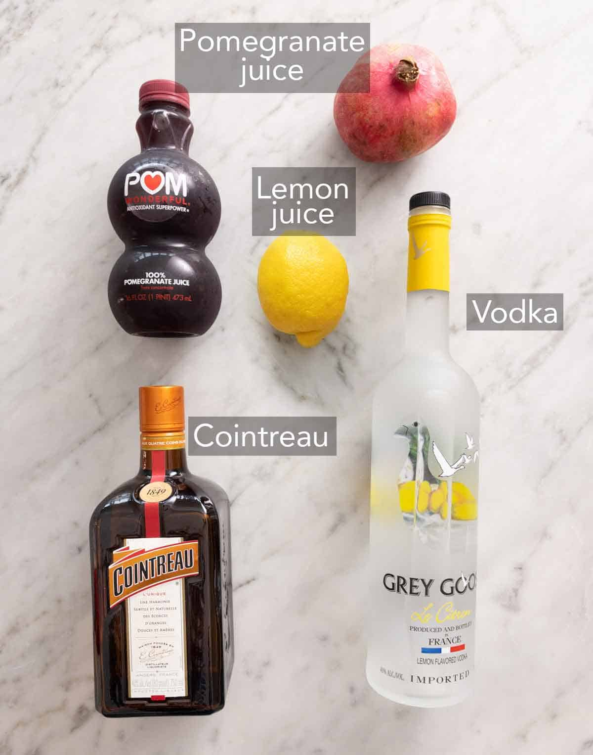 Ingredients needed to make a pomegranate martini.