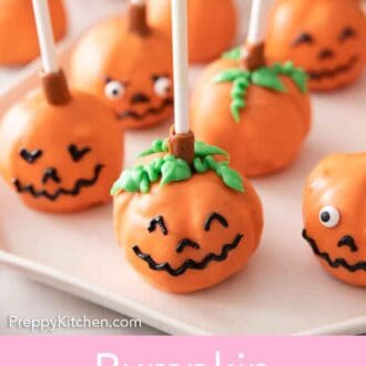 Pinterest graphic of a plate of pumpkin cake pops with faces on them.