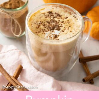 Pinterest graphic of a latte with pumpkin pie spice sprinkled over top with a jar of it in the background.