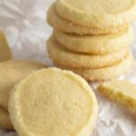 A group of butter cookies on parchment paper