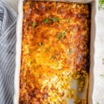 An overhead shot of corn casserole in a baking dish