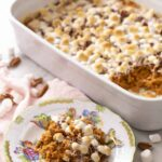 A sweet potato casserole topped with marshmallows and pecans.