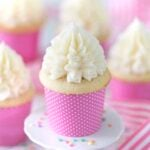 photo of moist Vanilla Cupcakes in pink paper wrappers